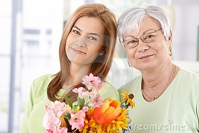 Portrait of mother and daughter at Mother s day