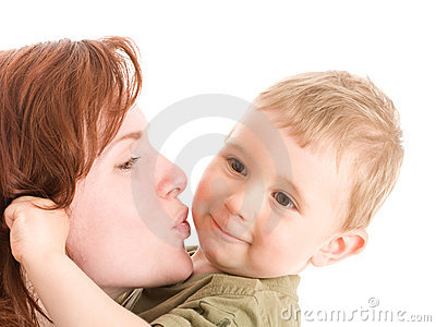 Portrait of mother kissing her son
