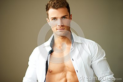 Portrait of muscular man posing in white shirt