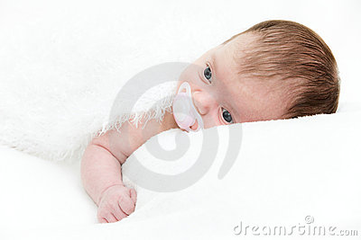 Portrait newborn baby lying in bed