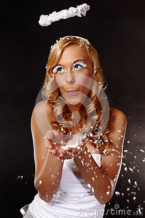 Portrait of a nice angel girl blow snow
