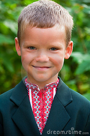 Portrait of nice little schoolboy