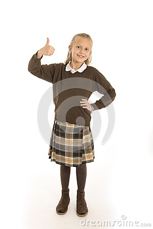 Free Portrait Of 7 Or 8 Years Old Beautiful And Happy Schoolgirl Female Child In School Uniform Smiling Cheerful Isolated On White Back Royalty Free Stock Image - 111538456