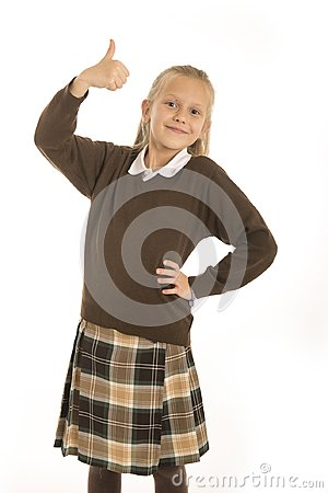 Free Portrait Of 7 Or 8 Years Old Beautiful And Happy Schoolgirl Female Child In School Uniform Smiling Cheerful Isolated On White Back Royalty Free Stock Photo - 111538465