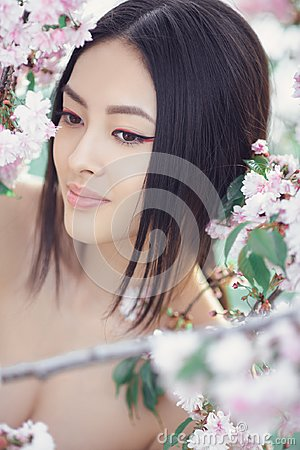 Free Portrait Of A Beautiful Fantasy Asian Girl Outdoors Against Natural Spring Flower Background. Royalty Free Stock Image - 116161356