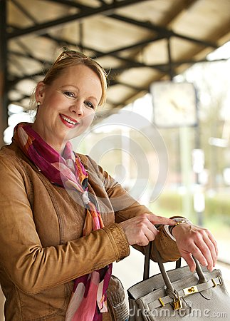 Free Portrait Of A Beautiful Woman Smiling And Pointing To Her Watch Stock Photos - 30598773