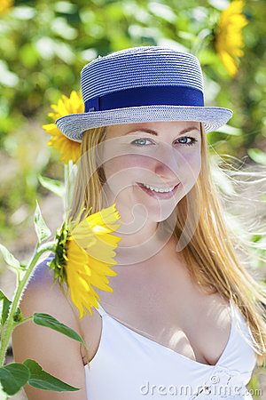 Free Portrait Of A Beautiful Young Blonde Woman In A White Dress On A Stock Photos - 71003763