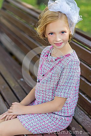 Free Portrait Of A Blonde In Pink Attire In A Park Outdoors. Stock Images - 99614734