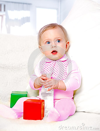 Free Portrait Of A Cheerful Little Girl Drinking Water From A Bottle Royalty Free Stock Photo - 28646765