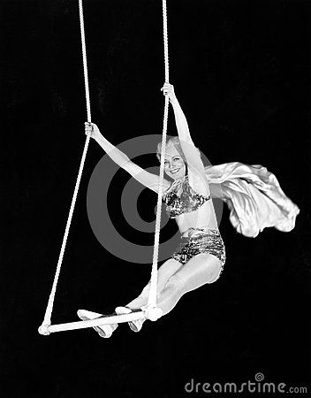 Free Portrait Of A Female Circus Performer Performing On A Trapeze Bar Royalty Free Stock Images - 52015569