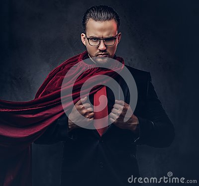 Free Portrait Of A Genius Superhero In A Black Suit With A Red Tie On A Dark Background. Stock Images - 118895384