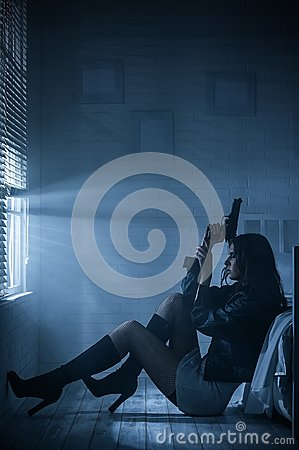 Free Portrait Of A Girl With A Gun Stock Photos - 30677053