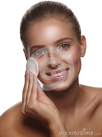 Free Portrait Of A Girl With Pure And Healthy Glowing Skin Without Makeup, Who Is Doing Daily Cleansing Procedures Using A Cotton Pad Royalty Free Stock Image - 119471366