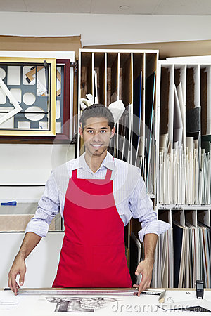 Free Portrait Of A Happy Young Skilled Worker Standing With Meter Stick In Workshop Stock Photography - 29670332