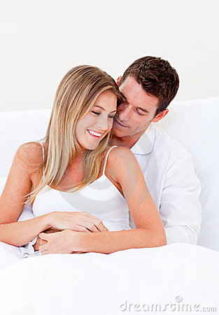 Free Portrait Of A Loving Couple Sitting On Bed Stock Photos - 13341743