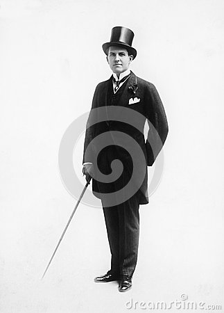 Free Portrait Of A Man In A Top Hat And Morning Suit Holding A Cane Stock Photo - 52017450