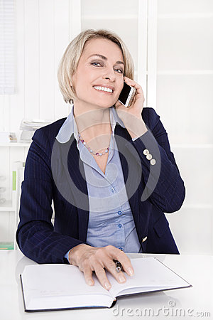 Free Portrait Of A Mature Or Senior Business Woman Flirting On Mobile Royalty Free Stock Images - 37579009
