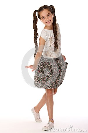 Free Portrait Of A Pretty Young Teenage Girl 12 Years Old In A Skirt With Bare Legs Royalty Free Stock Images - 112463409