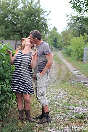 Free Portrait Of A Romantic Kiss In The Village Stock Images - 109407224