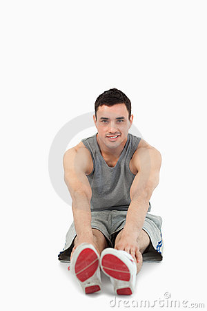 Free Portrait Of A Sports Man Stretching Up Royalty Free Stock Photo - 21974015