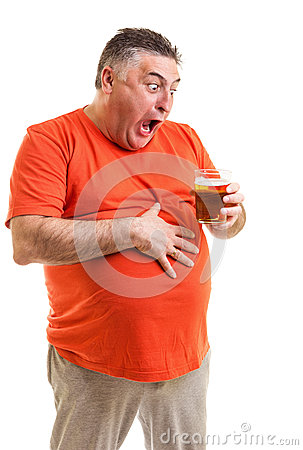 Free Portrait Of A Thirsty Fat Man Staring At A Glass Of Beer Royalty Free Stock Photo - 30923475