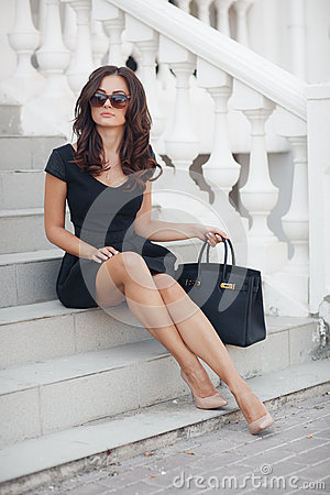 Free Portrait Of A Woman Sitting On The Steps Royalty Free Stock Image - 61060746