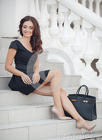 Free Portrait Of A Woman Sitting On The Steps Royalty Free Stock Image - 61060756