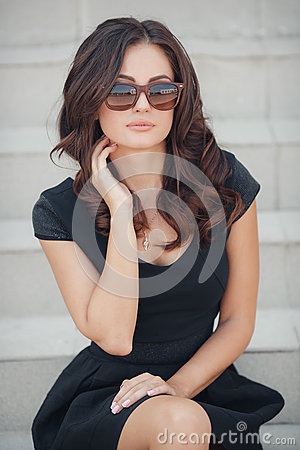 Free Portrait Of A Woman Sitting On The Steps Royalty Free Stock Image - 61062676