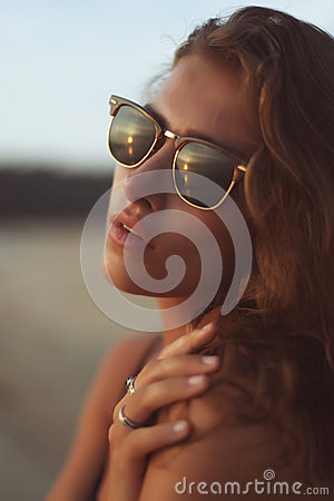 Free Portrait Of A Young Beautiful Woman With Long Curly Hair In Sunglasses Stock Photos - 43358193