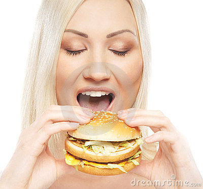 Free Portrait Of A Young Woman Eating A Cheeseburger Stock Photography - 23928942