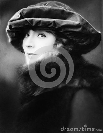 Free Portrait Of A Young Woman Wearing A Hat And A Fur Stole Royalty Free Stock Photography - 52015517