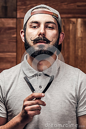 Free Portrait Of Bearded Hipster With Straight Edge Razor Royalty Free Stock Photo - 70747725