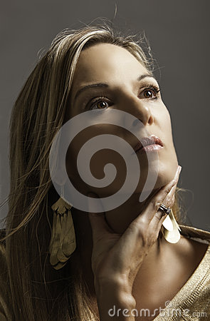 Free Portrait Of Beautiful Blonde Mature Woman In Gold Holding Her Hand To Her Throat Royalty Free Stock Photography - 31977667