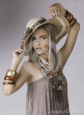 Free Portrait Of Beautiful Blonde Woman In Safari Clothing With Hat And Jewelry Stock Image - 34329121