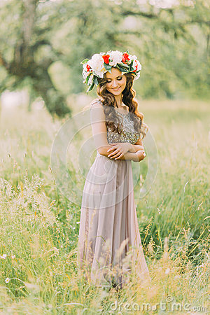 Free Portrait Of Beautiful Charming Young Lady In Flower Wreath And White Violet Dress Looking Down Royalty Free Stock Images - 70903059