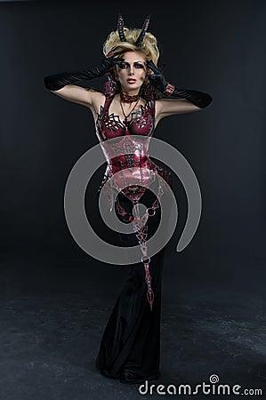 Free Portrait Of Beautiful Devil Woman In Dark Sexy Dress Royalty Free Stock Image - 59677696