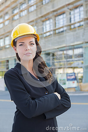 Free Portrait Of Beautiful Female Contractor Wearing Hard Hat At Construction S Stock Photos - 32349703