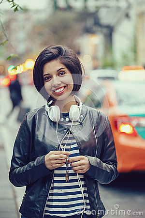 Free Portrait Of Beautiful Hispanic Latin Girl Woman Short Black Hair In Leather Jacket With Headphones Outside Royalty Free Stock Photo - 73233425