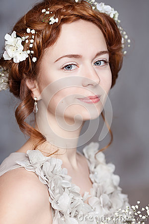 Free Portrait Of Beautiful Red-haired Bride. She Has A Perfect Pale Skin With Delicate Blush. White Flowers In Her Hair. Royalty Free Stock Photo - 66796695