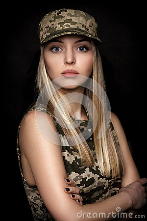 Free Portrait Of Beautiful Woman Soldiers In Military Attire On Black Background Royalty Free Stock Photo - 89052515
