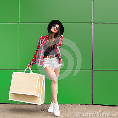 Free Portrait Of Beauty Fashion Smiling Woman With Shopping Bags In Sunglasses On Green Background. Outdoor. Copyspace Royalty Free Stock Images - 92833659