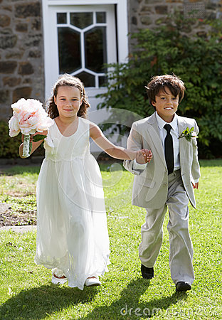 Free Portrait Of Bridesmaid With Page Boy Royalty Free Stock Photos - 33083018