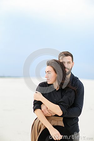 Free Portrait Of Caucasain Man Hugging Woman In Monophonic Background. Stock Image - 117354521