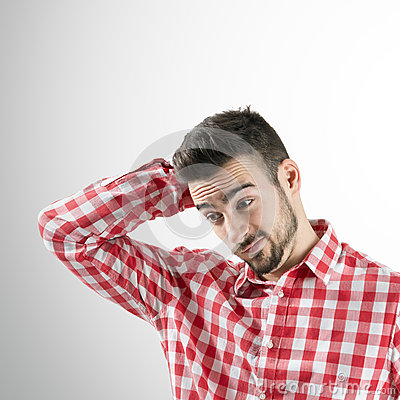 Free Portrait Of Confused Young Bearded Man Looking Down. Stock Photography - 47956362