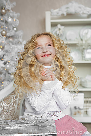 Free Portrait Of Dreaming Blonde Little Girl In Christmas Decorated Studio Stock Photography - 80333752