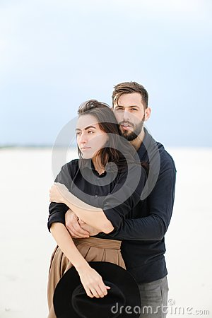 Free Portrait Of European Man Hugging Woman In Monophonic Background. Stock Photos - 116691133