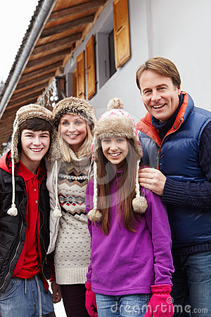 Free Portrait Of Family Standing Outside Chalet Royalty Free Stock Image - 24384336