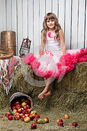 Free Portrait Of Funny Girl Near Pail With Apples Royalty Free Stock Image - 27893296