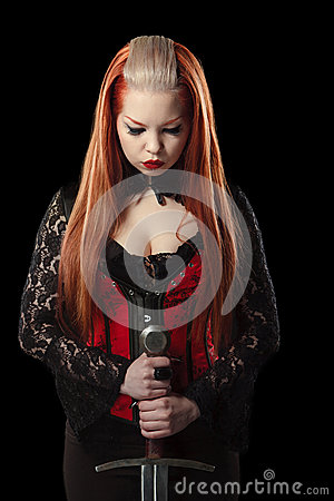 Free Portrait Of Gorgeous Redhead Woman With Long Sword Royalty Free Stock Photo - 47899555