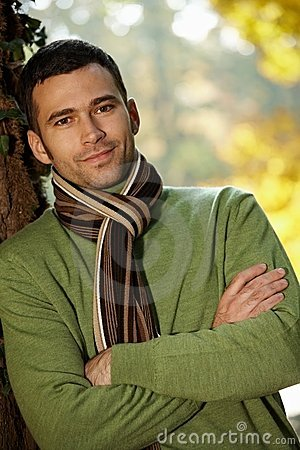 Free Portrait Of Handsome Young Man In Autumn Park Stock Image - 16145101